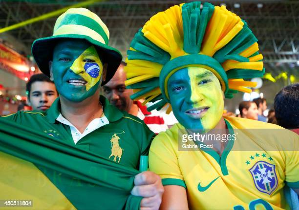 Fans of Brazil pose during the FIFA Fan Fest for the opening game of the FIFA World Cup 2014 between Brazil and Croatia at ExpoMinas on June 12, 2014...