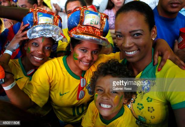 Fans of Brazil pose during the FIFA Fan Fest for the opening game of the FIFA World Cup 2014 between Brazil and Croatia at ExpoMinas on June 12 2014...