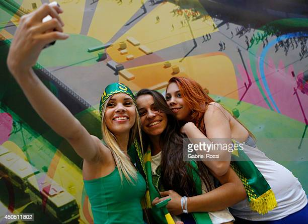 Fans of Brazil take a picture before the FIFA Fan Fest for the opening game of the FIFA World Cup 2014 between Brazil and Croatia at ExpoMinas on...