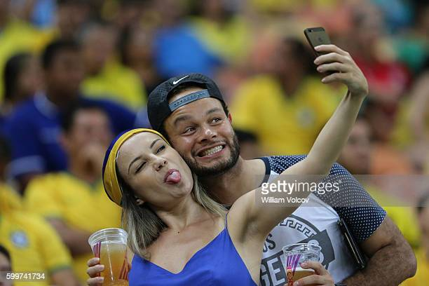 Fans of Brazil take a selfie before a match between Brazil and Colombia as part of FIFA 2018 World Cup Qualifiers at Arena Amazonia Stadium on...