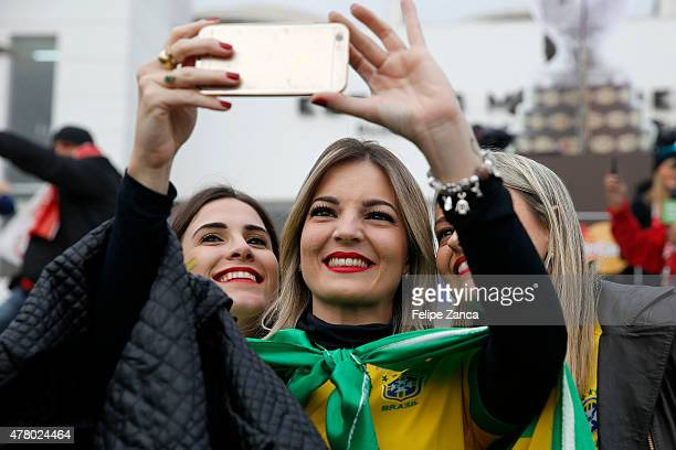 Fans of Brazil take a selfie prior the 2015 Copa America Chile Group C match between Brazil and Venezuela at Monumental David Arellano Stadium on...