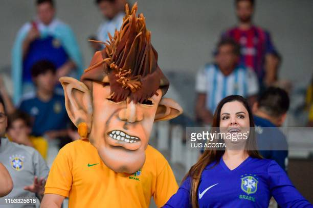 Fans of Brazil wait for the start of the Copa America football tournament semifinal match against Argentina at the Mineirao Stadium in Belo Horizonte...
