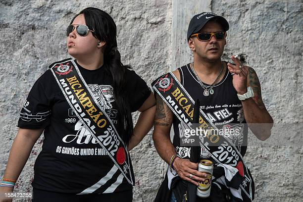 Fans of Brazilian club Corinthians celebrate in Sao Paulo Brazil on December 16 2012 the team's victory in the 2012 Club World Cup football final...