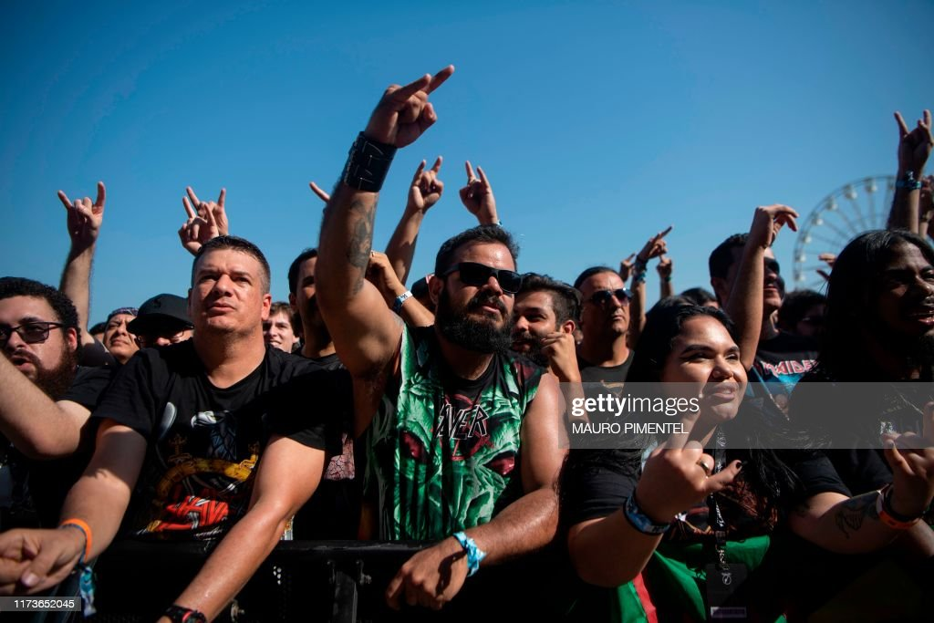 Fans of Brazilian rock band Nervosa enjoy the concert on the ...