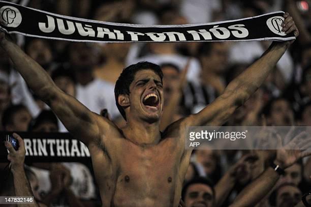 Fans of Brazil's Corinthians cheer before their Copa Libertadores 2012 second leg final match against Argentina's Boca Juniors at Pacaembu stadium in...
