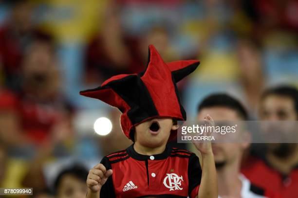 Fans of Brazil's Flamengo cheer before the Copa Sudamericana first leg semifinal football match against Colombia's Junior de Barranquilla at Maracana...