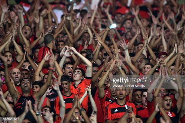 Fans of Brazil's Flamengo cheer before their Copa Libertadores football match against Mexico's Leon at the Mario Filho 'Maracana' stadium in Rio de...