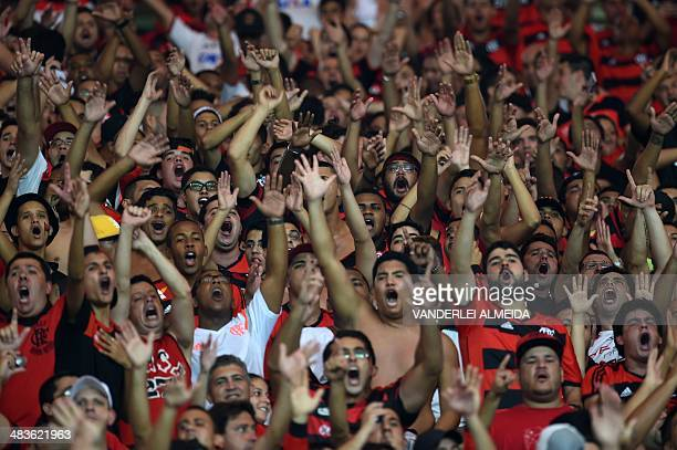 Fans of Brazil's Flamengo cheer before their Copa Libertadores football match against Mexico's Leon at the Mario Filho 'Maracana' stadium in Rio de...