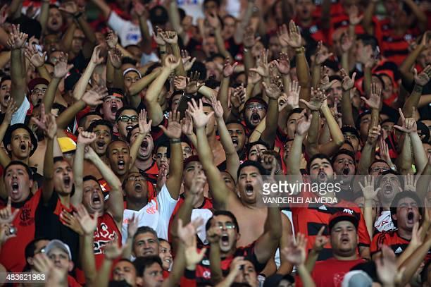 "Fans of Brazil's Flamengo cheer before their Copa Libertadores football match against Mexico's Leon at the Mario Filho ""Maracana"" stadium in Rio de..."