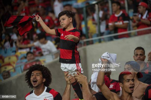Fans of Brazil's Flamengo cheer players before their Libertadores Cup football match against Argentina's San Lorenzo at Maracana stadium in Rio de...
