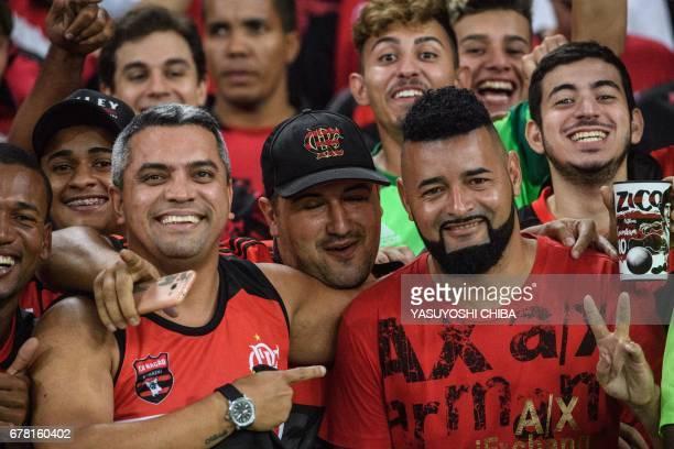 Fans of Brazil's Flamengo pose before their Copa Libertadores 2017 football match against Chile's Universidad Catolica at Maracana stadium in Rio de...