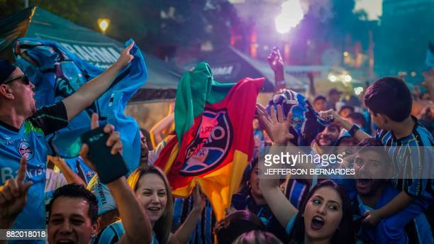 Fans of Brazil's Gremio watch their team during the 2017 Copa Libertadores game against Argentina's Lanus at a bar in Porto Alegre Brazil on November...