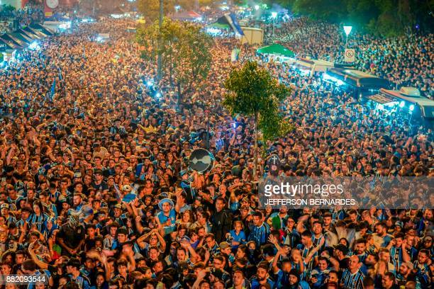 TOPSHOT Fans of Brazil's Gremio watch their team during the 2017 Copa Libertadores game against Argentina's Lanus on the streets of Porto Alegre...