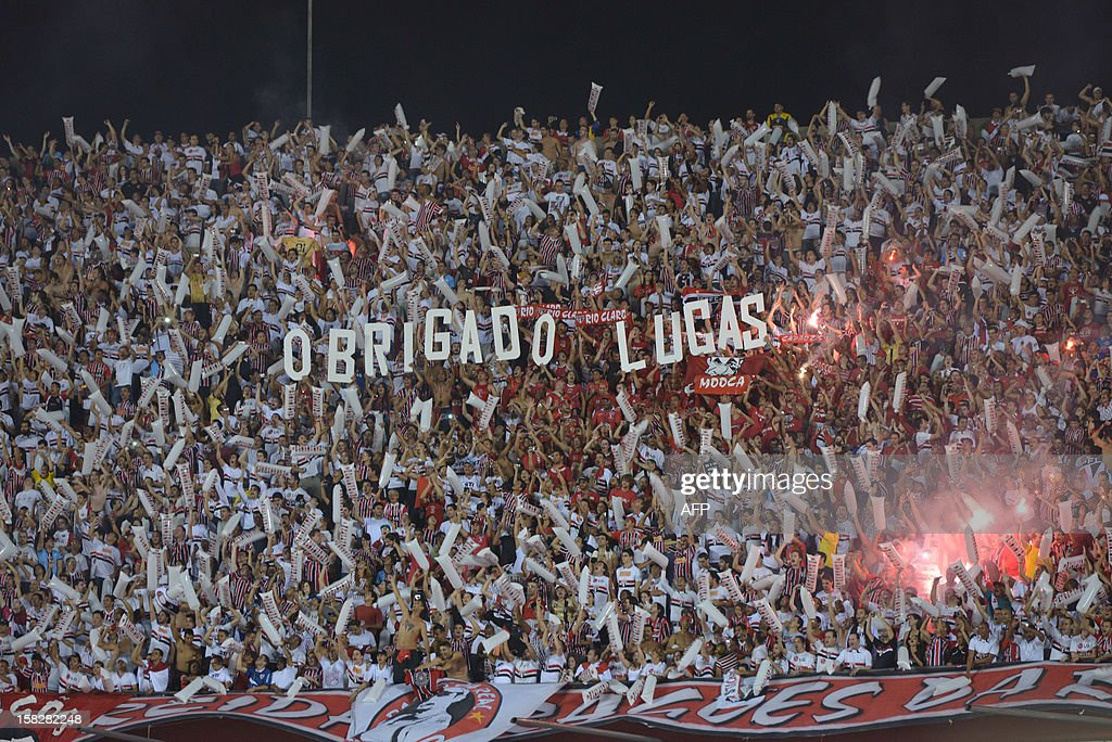 Fans of Brazil's Sao Paulo show a sign that reads 'Thank you Lucas' before their Copa Sudamericana football final match against Argentina's Tigre at Morumbi stadium in Sao Paulo, Brazil, on December 12, 2012. AFP Photo/Yasuyoshi CHIBA