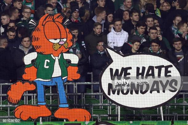 Fans of Bremen protest against the new Monday night kickoff times prior to the Bundesliga match between SV Werder Bremen and 1 FC Koeln at...