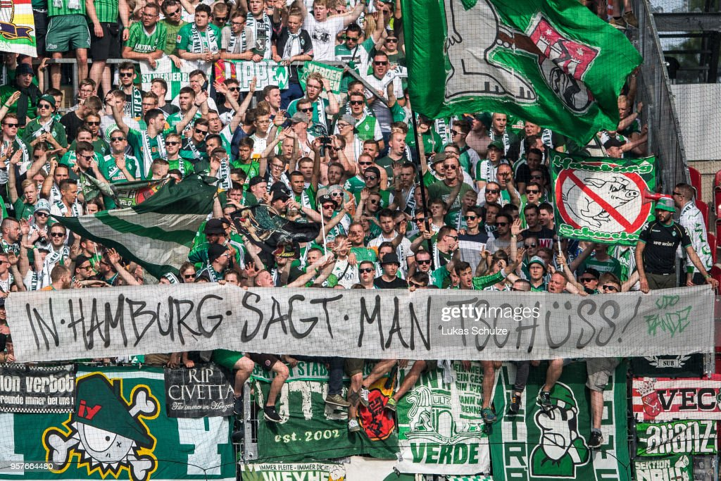 Fans of Bremen show a banner against Hamburger SV during the Bundesliga match between 1. FSV Mainz 05 and SV Werder Bremen at Opel Arena on May 12, 2018 in Mainz, Germany.