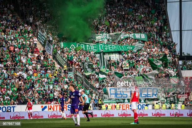 Fans of Bremen show a banner against Hamburger SV during the Bundesliga match between 1 FSV Mainz 05 and SV Werder Bremen at Opel Arena on May 12...
