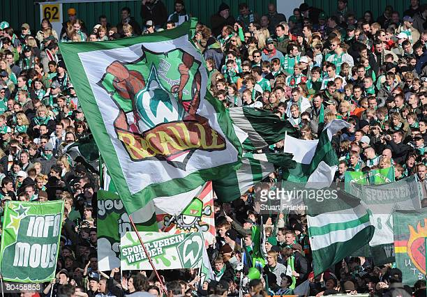 Fans of Bremen wave their falgs during the Bundesliga match between Werder Bremen and MSV Duisburg at the Weser stadium on March 29 2008 in Bremen...