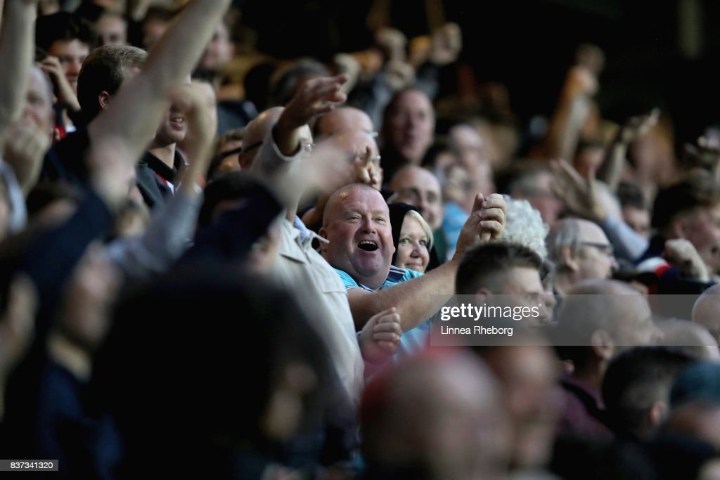 Fans of Brentford celebrate after Ariel Borysiuk scored their first goal during the Carabao Cup Second Round match between Queens Park Rangers and Brentford at Loftus Road on August 22, 2017 in London, England.