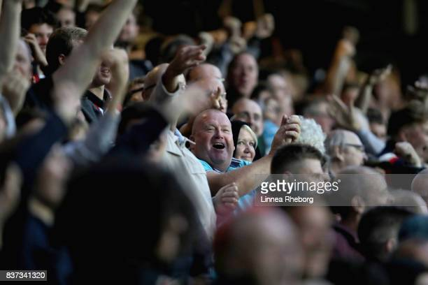 Fans of Brentford celebrate after Ariel Borysiuk scored their first goal during the Carabao Cup Second Round match between Queens Park Rangers and...