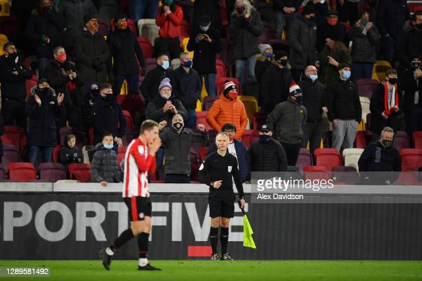 Fans of Brentford celebrate after Sergi Canos of Brentford scores his sides second goal during the Sky Bet Championship match between Brentford and...
