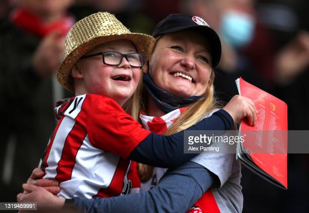 Fans of Brentford celebrate at full time during the Sky Bet Championship Play-off Semi Final 2nd Leg match between Brentford and AFC Bournemouth at...