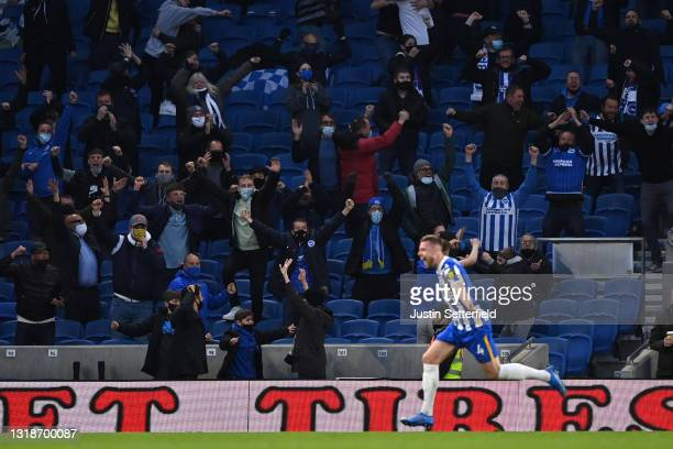Fans of Brighton and Hove Albion celebrate their side's second goal scored by Adam Webster of Brighton and Hove Albion during the Premier League...