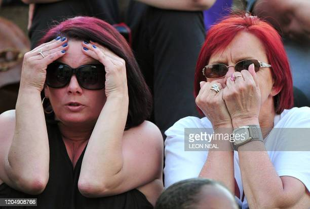 Fans of British player Andy Murray watch on a big screen the semi final between Murray and Spanish player Rafael Nadal at the Wimbledon Tennis...