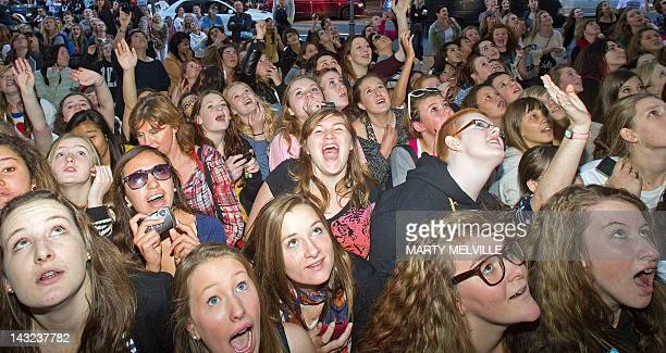 Fans of BritishIrish boy band One Direction wait for a glimpse of their idols ahead of a concert in Wellington on April 22 2012 One Direction...