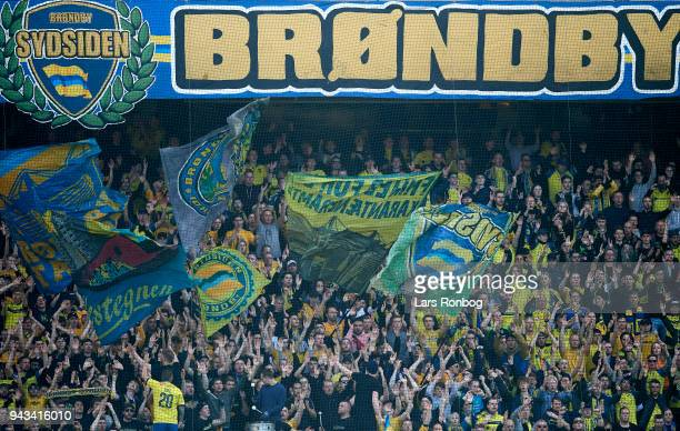 Fans of Brondbvy IF cheer with flags during the Danish Alka Superliga match between Brondby IF and AC Horsens at Brondby Stadion on April 8 2018 in...