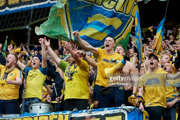 Fans of Brondby celebrate after the Danish Alka Superliga match between Brondby IF and FC Copenhagen at Brondby Stadion on April 15 2018 in Brondby...