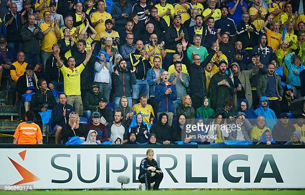 Fans of Brondby cheer during the Danish Alka Superliga match between Brondby IF and FC Copenhagen at Brondby Stadion on August 28 2016 in Brondby...