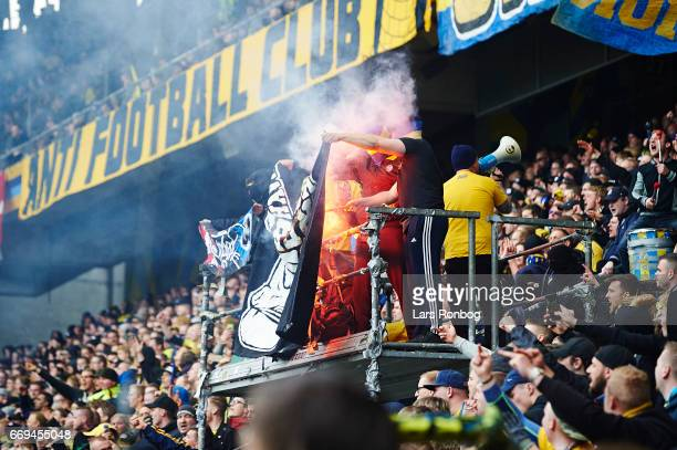 Fans of Brondby IF burning a FC Copenhagen banner during the Danish Alka Superliga match between Brondby IF and FC Copenhagen at Brondby Stadion on...