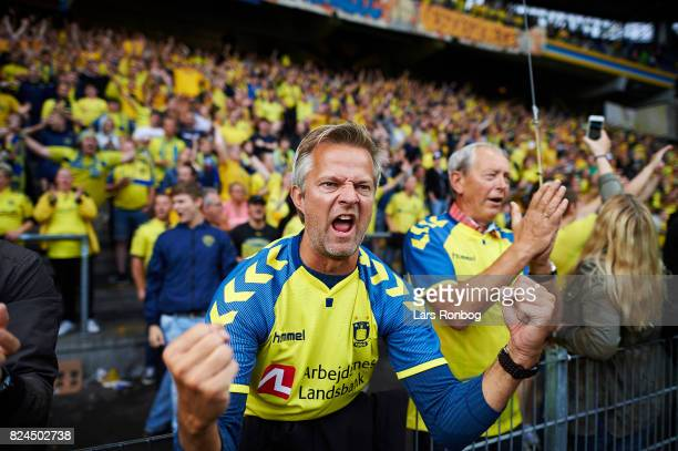 Fans of Brondby IF celebrate after the Danish Alka Superliga match between Brondby IF and Lyngby BK at Brondby Stadion on July 30 2017 in Brondby...