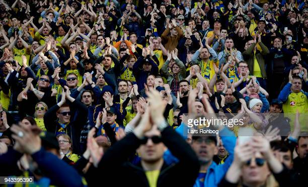 Fans of Brondby IF celebrate after the Danish Alka Superliga match between Brondby IF and AC Horsens at Brondby Stadion on April 8 2018 in Brondby...