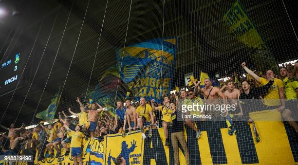 Fans of Brondby IF celebrate after the Danish Alka Superliga match between FC Midtjylland and Brondby IF at MCH Arena on April 19 2018 in Herning...