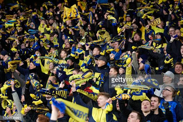 Fans of Brondby IF celebrate from the stands after the Danish 3F Superliga match between Brondby IF and Lyngby BK at Brondby Stadion on March 01,...