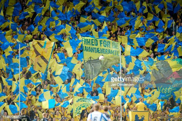 Fans of Brondby IF cheer at the stands during the Danish Superliga match between OB Odense and Brondby IF at Nature Energy Park on May 25, 2019 in...