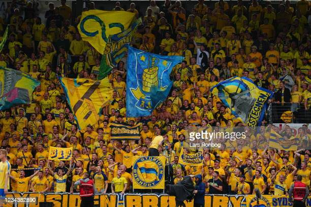 Fans of Brondby IF cheer during the Danish 3F Superliga match between Vejle Boldklub and Brondby IF at Vejle Stadion on August 1, 2021 in Vejle,...
