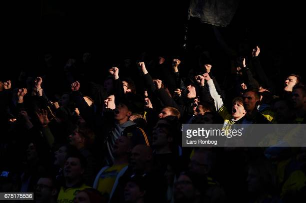 Fans of Brondby IF cheer during the Danish Alka Superliga match between Brondby IF and Sondejryske at Brondby Stadion on April 30 2017 in Brondby...