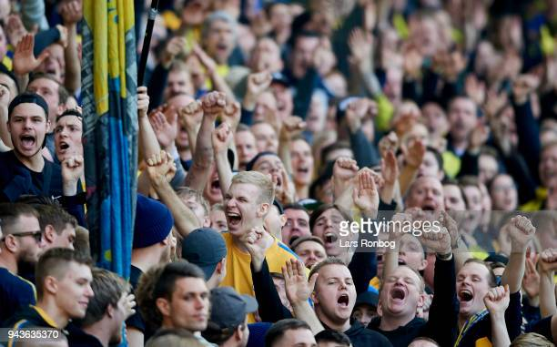 Fans of Brondby IF cheer during the Danish Alka Superliga match between Brondby IF and AC Horsens at Brondby Stadion on April 8 2018 in Brondby...