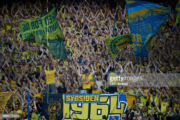 Fans of Brondby IF cheer during the Danish Alka Superliga match between Brondby IF and FC Midtjylland at Brondby Stadion on May 14 2018 in Brondby...