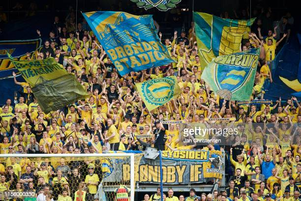 Fans of Brondby IF cheer from the stands during the Danish 3F Superliga match between Brondby IF and Silkeborg IF at Brondby Stadion on July 14 2019...