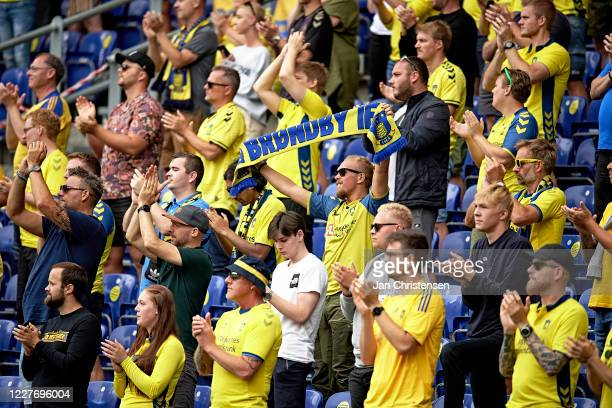 Fans of Brondby IF cheer from the stands prior to the Danish 3F Superliga match between Brondby IF and AaB Aalborg at Brondby Stadion on July 19,...