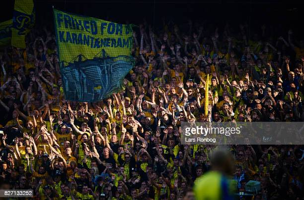 Fans of Brondby IF cheer in the sun during the Danish Alka Superliga match between Brondby IF and FC Copenhagen at Brondby Stadion on August 6 2017...