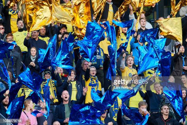 Fans of Brondby IF cheer with a tifo during the Danish Superliga match between AGF Aarhus and Brondby IF at Ceres Park on September 23 2018 in Aarhus...