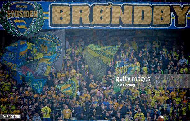 Fans of Brondby IF cheer with flags during the Danish Alka Superliga match between Brondby IF and AC Horsens at Brondby Stadion on April 8 2018 in...