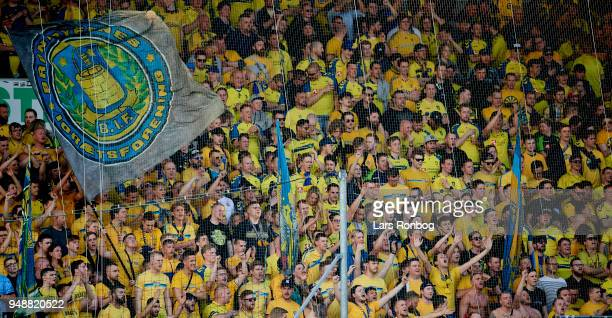 Fans of Brondby IF cheer with flags during the Danish Alka Superliga match between FC Midtjylland and Brondby IF at MCH Arena on April 19 2018 in...