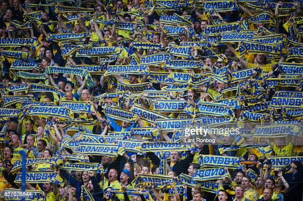 Fans of Brondby IF cheer with scarfs during the Danish Alka Superliga match between Brondby IF and FC Copenhagen at Brondby Stadion on August 6 2017...