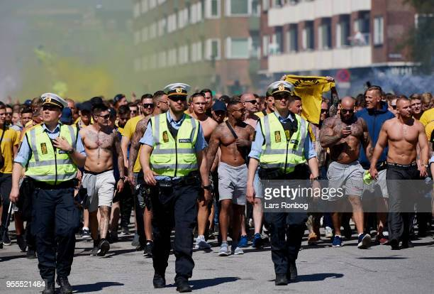 Fans of Brondby IF walking in the streets towards the stadium prior to the Danish Alka Superliga match between FC Copenhagen and Brondby IF at Telia...